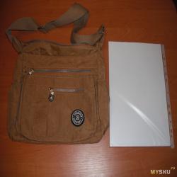 Легкая нейлоновая дамская сумка, которая понравилась.